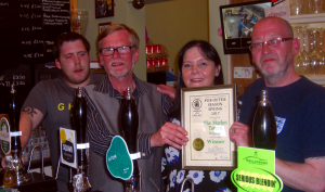 Richard Lee (second left), presents Adam, Debbie and Snap with the Pub of the Season certificate